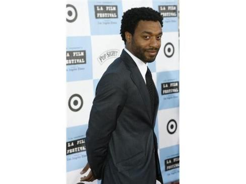 Chiwetel Ejiofor with his hair longer but still tapered and neatly groomed.