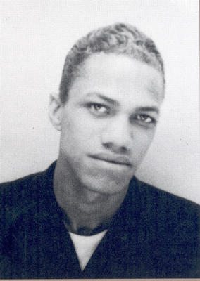 A picture of a young Malcolm X with chemically-altered hair.