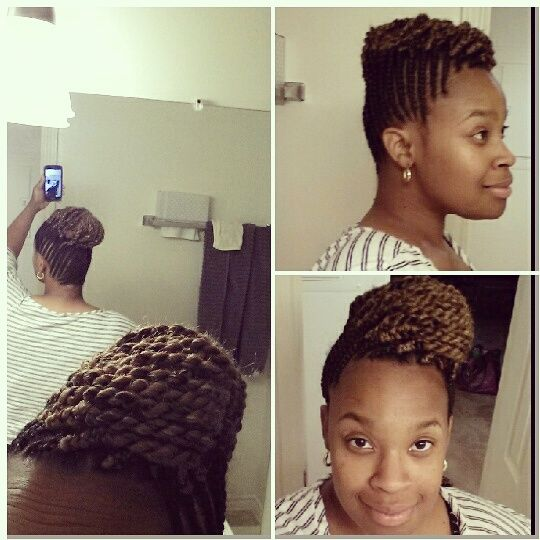 Corn rows braided up into two-strand twists updo.